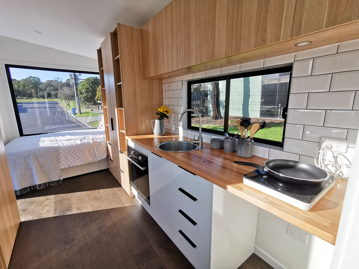 Anchor Tiny House by Hangan Interior Kitchen and Bed Space Storage Victoria Australia