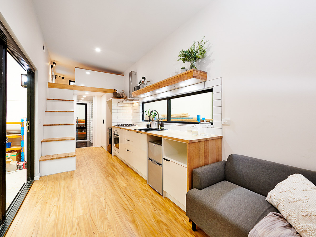 Cradle Mountain 11 meter Tiny House by Hangan Interior View Kitchen Storage Staircase and Living Space Victoria Australia